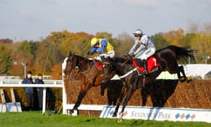 Santini and Nico De Boinville, right, on his way to winning at Sandown