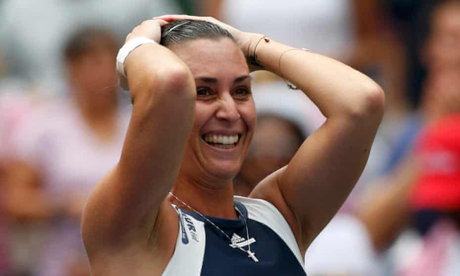 Flavia Pennetta of Italy celebrates after reaching her first slam final with a two-set victory over Simona Halep .