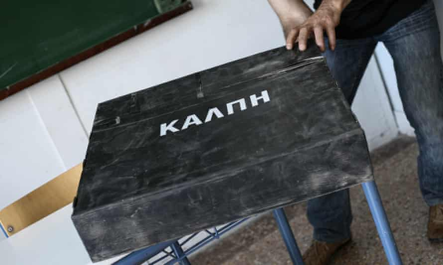 Municipality workers prepare ballot boxes in Athens.