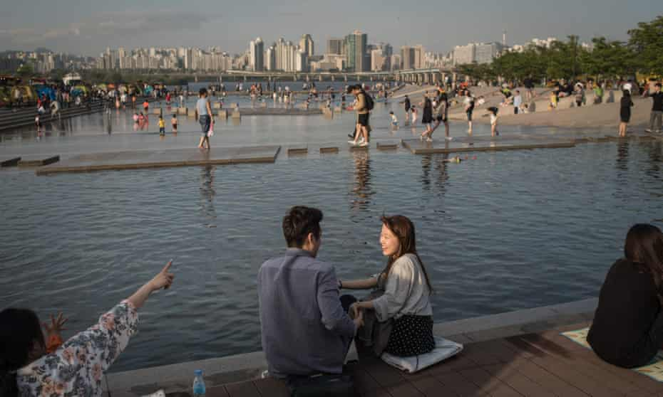 Han river and the city skyline, at Yeouido park in Seoul.