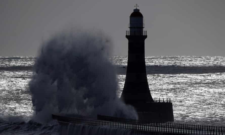 Huge waves crash against Roker lighthouse and pier in Sunderland on 6 April.