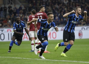 Inter's Lautaro Martínez, centre, leads the celebrations after Milan take the lead.