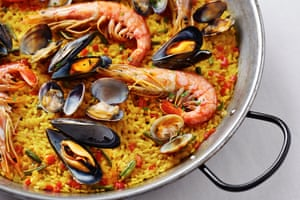 Spanish paella made in a traditional pan – the original of the dish did not feature seafood, but chicken, rabbit and, occasionally, snails.