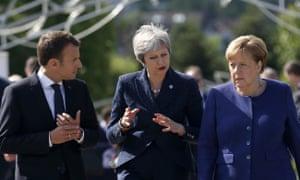 Angela Merkel, Theresa May and Emmanuel Macron.