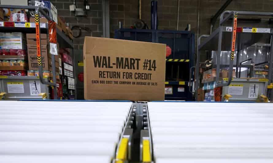 A box of merchandise is unloaded from a truck and sent along a conveyor belt at a Walmart Supercenter in Houston.