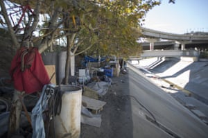 Homeless encampments line the banks above the concreted channel of the Arroyo Seco Creek