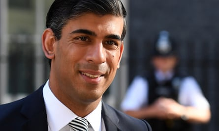 Rishi Sunak, with a police officer in the background