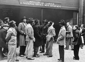 A group of men wait outside the labour exchange in Liverpool in 1949