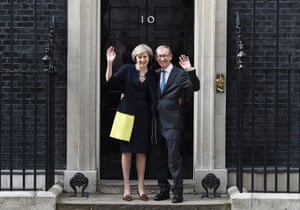 British Prime Minister Theresa May with her husband Philip wave to the media upon their arrival at No. 10 Downing Street