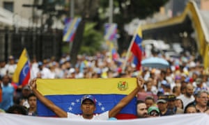 An opposition member holds a Venezuelan national flag during a protest march against Nicolás Maduro in Caracas Wednesday.