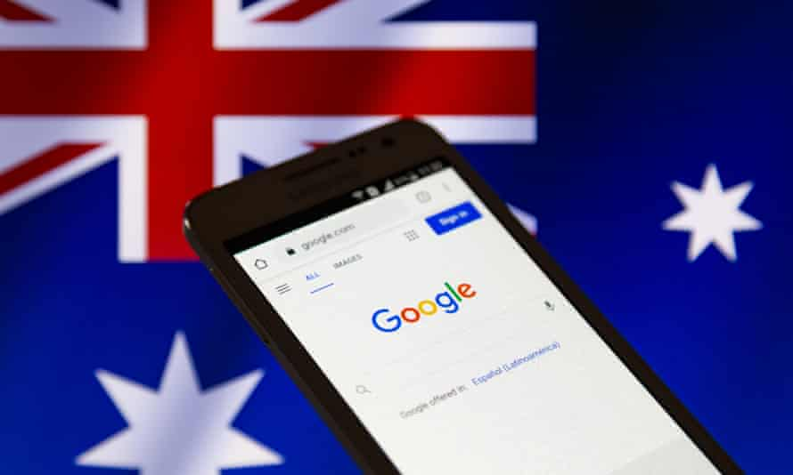 Google seen on a smartphone in front of an Australian flag