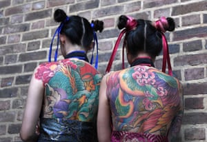 Two girls show off their tattoos