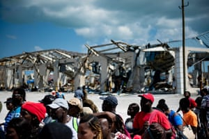 People board a cargo ship for evacuation to Nassau after Hurricane Dorian hit Great Abaco, Bahamas