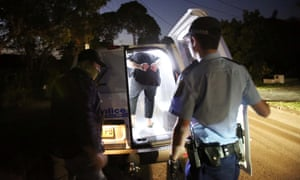 A handout picture released by NSW Police shows police making arrests during a raid at Merrylands in Sydney, Australia