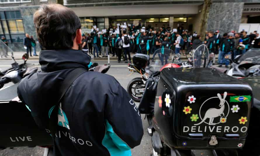 Deliveroo riders holding a protest over pay outside the company's London HQ last month