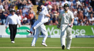 Chris Rogers leaves the field after being dismissed for 95 as bowler Mark Wood and Adam Lyth celebrate.
