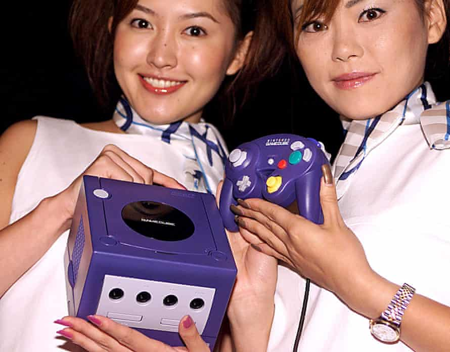 Nintendo employees and the GameCube in 2001.
