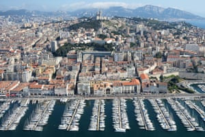 'There's no boundary outside of which to put poor people' ... Marseille, looking up to the tower from the Vieux Port.