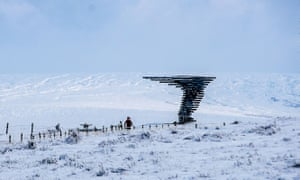 Snow around the Singing Ringing Tree wind-powered sound sculpture set in the landscape of the Pennine hill range overlooking Burnley, Lancashire