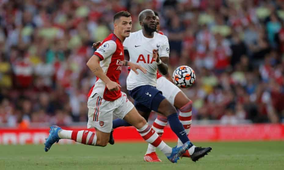 Arsenal's Granit Xhaka tangles with Tottenham's Tanguy Ndombele