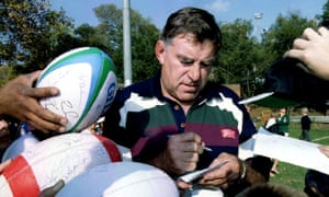 New Zealand's team manager Colin Meads signs autographs for school children in 1995.