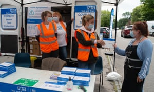 Covid-19 lateral flow test packs being given out to members of the public in Beaconsfield, England.