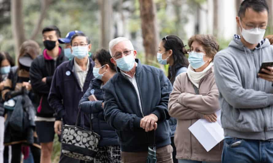 People queue for vaccines in Homebush, Sydney