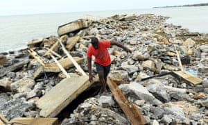 A man walks along a destroyed docking bay