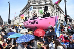 Protesters block the road during Extinction Rebellion climate change protests on Oxford Circus