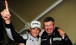 Button celebrates clinching the 2009 world title with Ross Brawn after the Brazilian Grand Prix at Interlagos