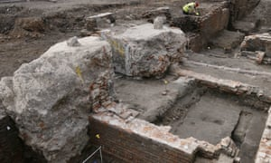 An archaeologist works on the exposed remains of Shakespeare's Curtain theatre