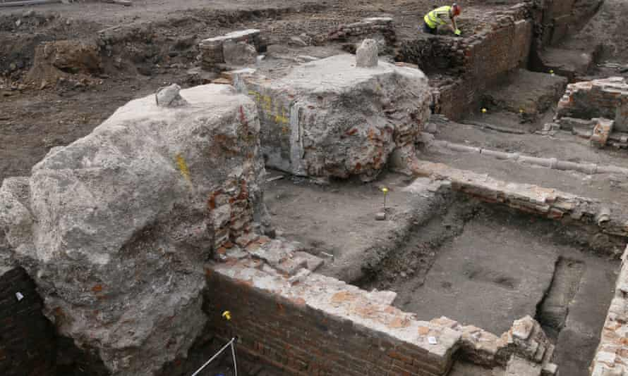 An archaeologist works on the exposed remains as the site of Shakespeare's Curtain theatre is excavated in Shoreditch.