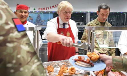 Johnson serves Christmas lunch to British troops stationed in Estonia last year
