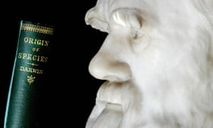 One of the earliest copies of The Origin of Species next to a life-size bust of Darwin himself.