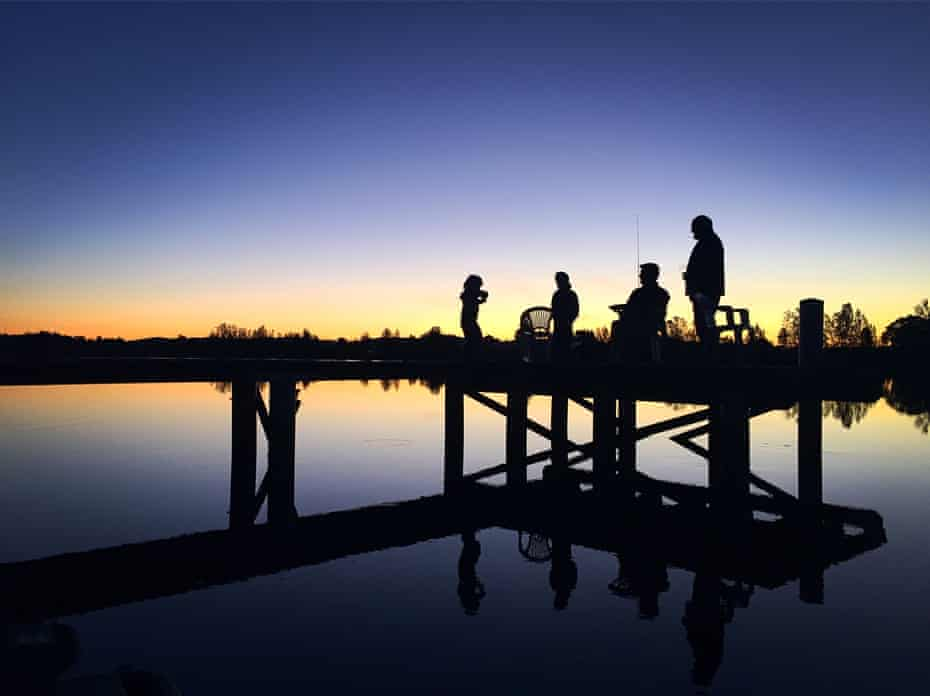 Children and adults fish on the Manning River in Taree