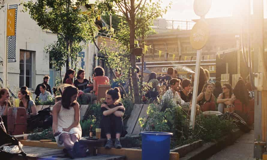 Parisians enjoy the sunshine at Les Grands Voisins.
