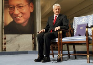 Chairman of the Nobel Committee Thorbjoern Jagland looks down at the vacant chair reserved for Nobel Laureate Liu Xiaobo (portrait at left), in Oslo, on 10 Dec, 2010.