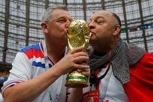 England fans inside the Luzhniki Stadium give a replica trophy a good luck kiss.