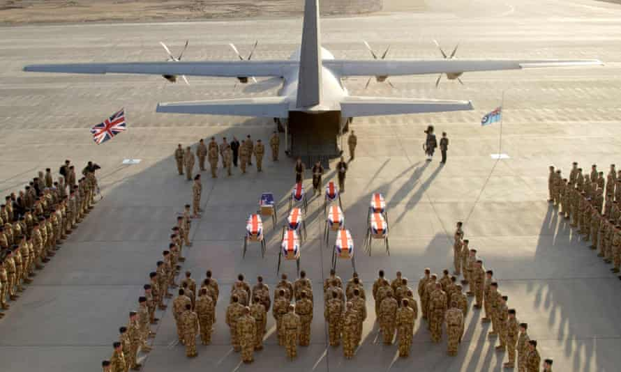 The coffins of military personnel killed when a British Hercules aircraft crashed in Iraq.