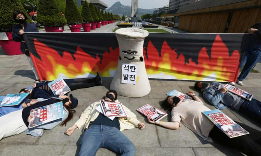 Members of an environmental activist group perform during a rally to call for the dismantling of coal-fired power plants by 2030 as part of efforts to raise public awareness about the harmful effects of coal on people's health, in Seoul, South Korea,