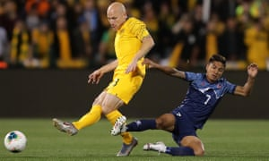 Aaron Mooy is tackled by Nepal's Abhishek Rijal