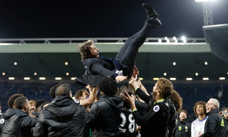 Antonio Conte is thrown into the air by his players as Chelsea celebrate winning the Premier League title at West Bromwich Albion in May 2017.