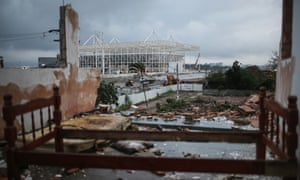 As construction of the Olympic aquatics stadium continues, a bed frame remains in a partially demolished home. But how will the 2016 Games affect the lives of the city's favela population?