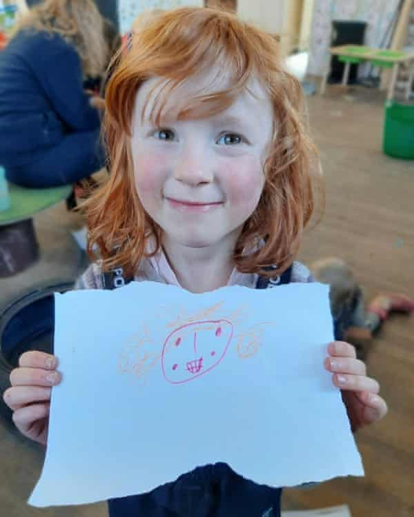 Astrid Cooper, five, with her self-portrait
