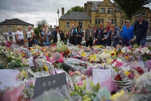 Birstall, England: People look at floral tributes left in memory of murdered Labour MP Jo Cox