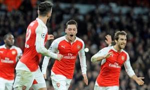 Mesut Özil celebrates scoring the opener.