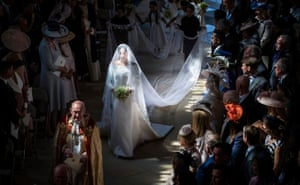 Meghan Markle walks down the aisle in St George's chapel at Windsor castle at her wedding to England's Prince Harry. The wedding was held on 19 May 2018.