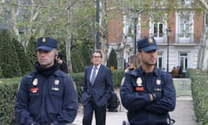 Artur Mas, a former president of Catalonia, walks outside the national court in Madrid. Ousted Catalan government members and lawmakers began arriving at two Spanish courts in Madrid on Thursday to face possible charges of rebellion for having declared the region's independence.