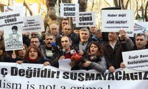 Turkish journalists hold a banner reading 'Journalism is not a crime' during a demonstration in support of Dündar and Gul in January in Ankara.