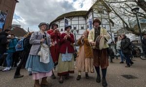 Musicians in period costume outside London's Globe Theatre.